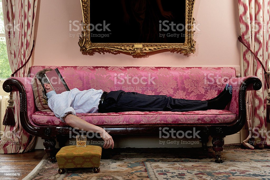 Relaxing on sofa royalty-free stock photo