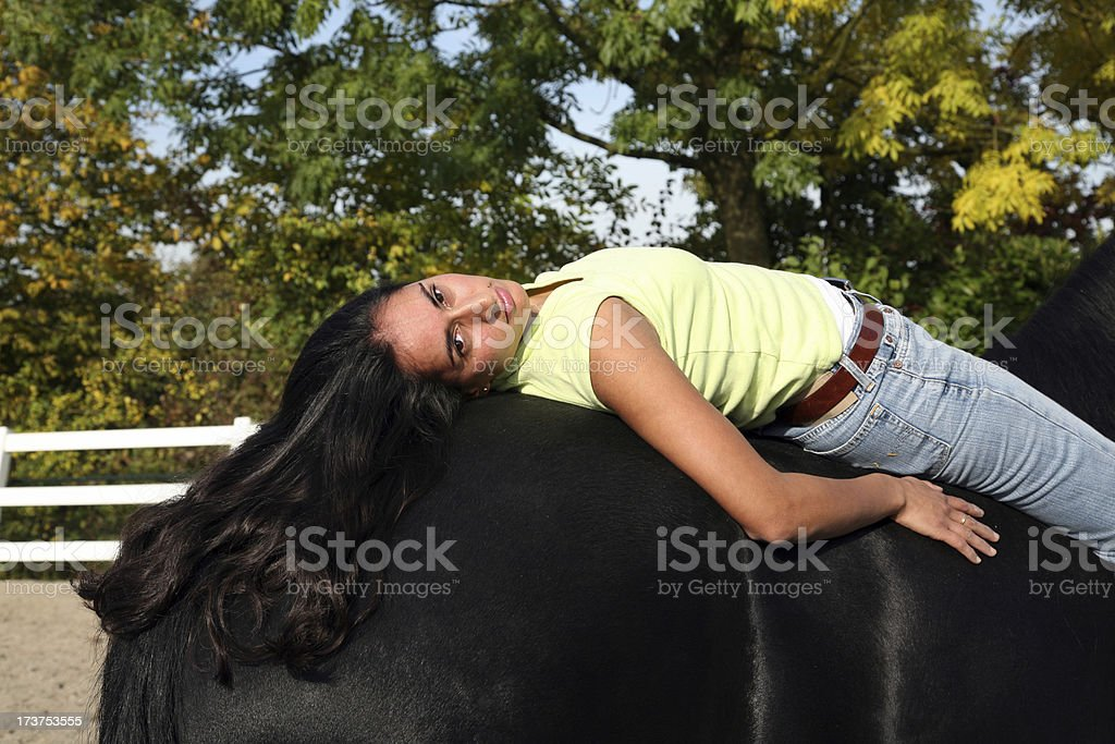 Relaxing on the back of my horse stock photo