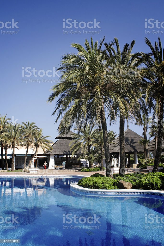 Relaxing pool resort royalty-free stock photo