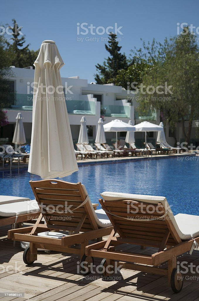 Relaxing Poolside Getaway Background royalty-free stock photo