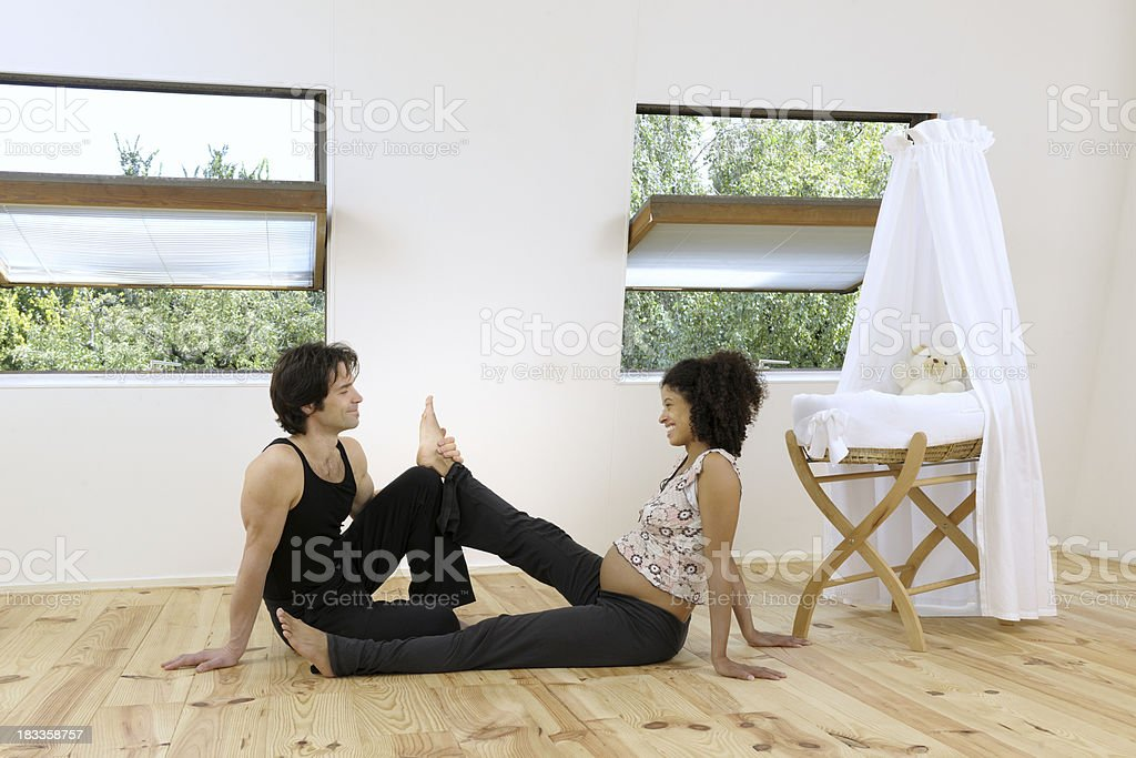 relaxing pregnant woman and man in nursery XXXL image royalty-free stock photo