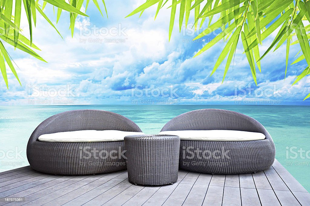 Relaxing rattan sofa beds stock photo