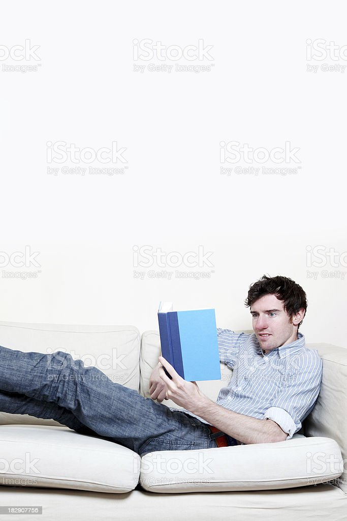 Relaxing reading a book royalty-free stock photo
