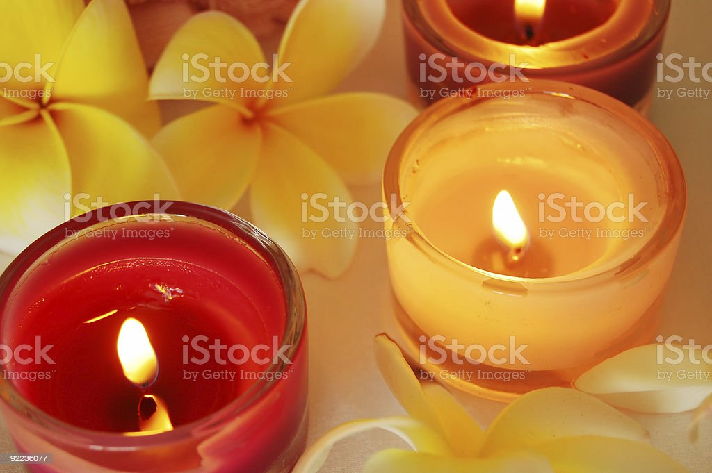 Relaxing scene of burning candles and aromatic flowers royalty-free stock photo