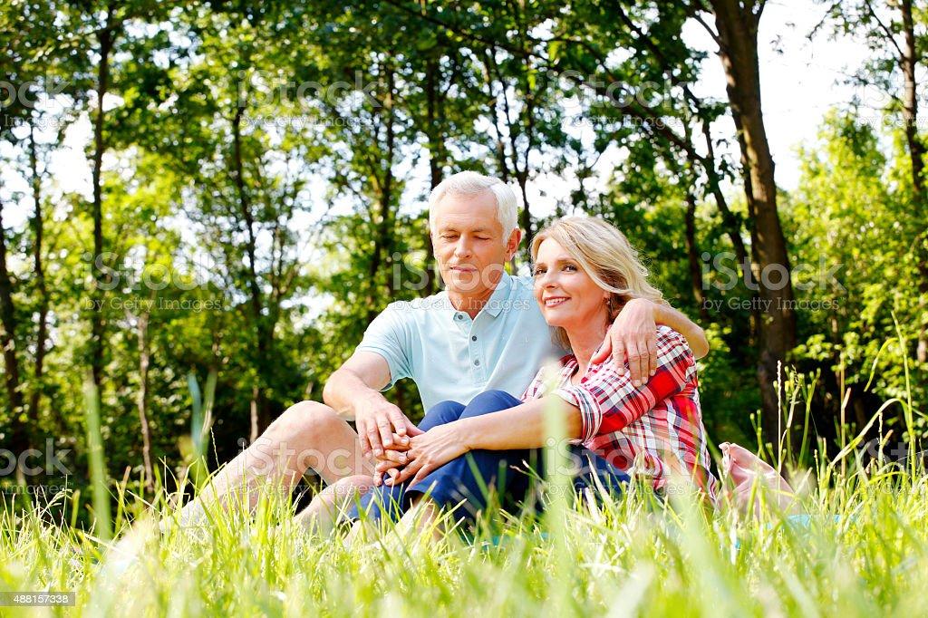 Relaxing senior couple stock photo