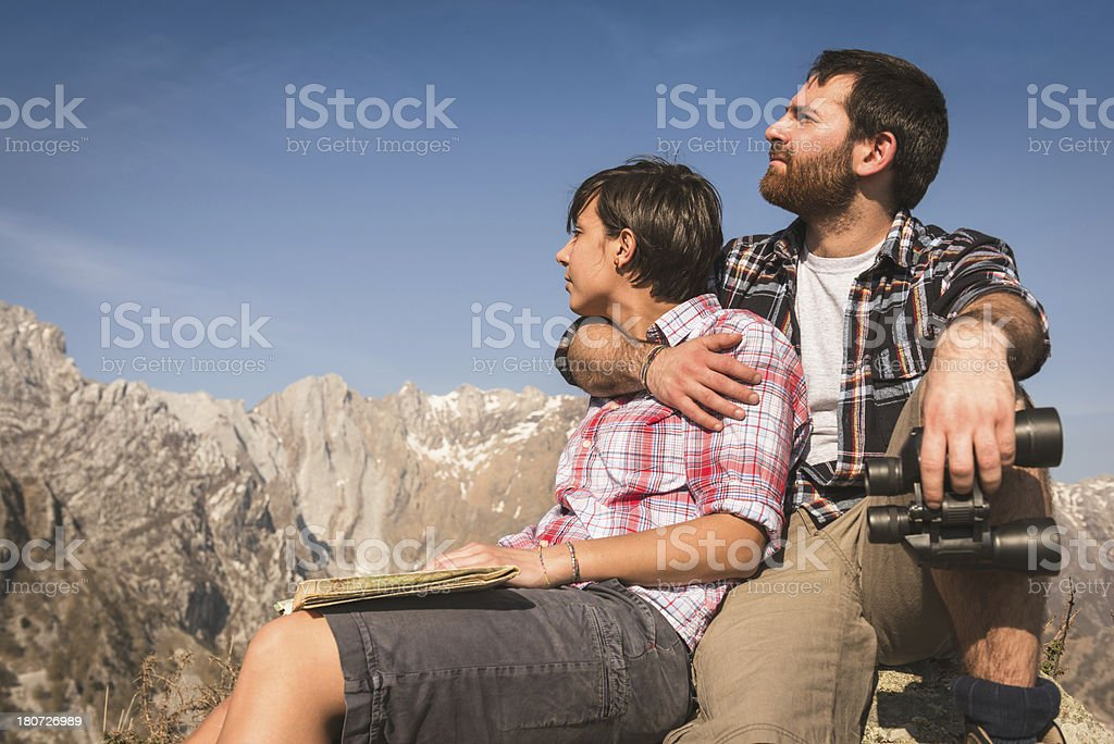 relaxing sitting on top of the mountain royalty-free stock photo