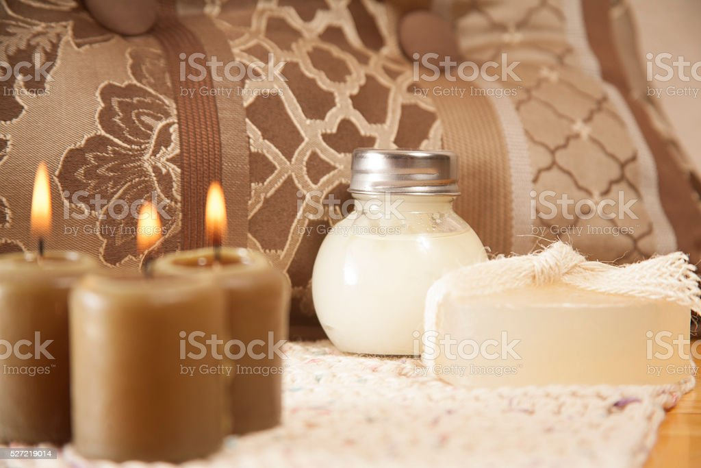 Relaxing spa treatment.  Burning candles, bath salts, soap. stock photo