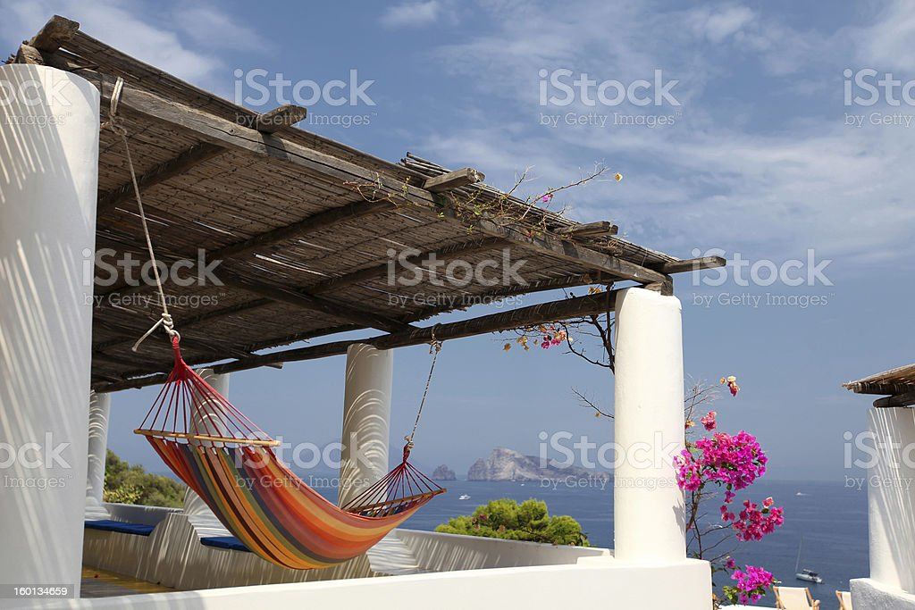 Relaxing spot in the island of Panarea in Sicily stock photo