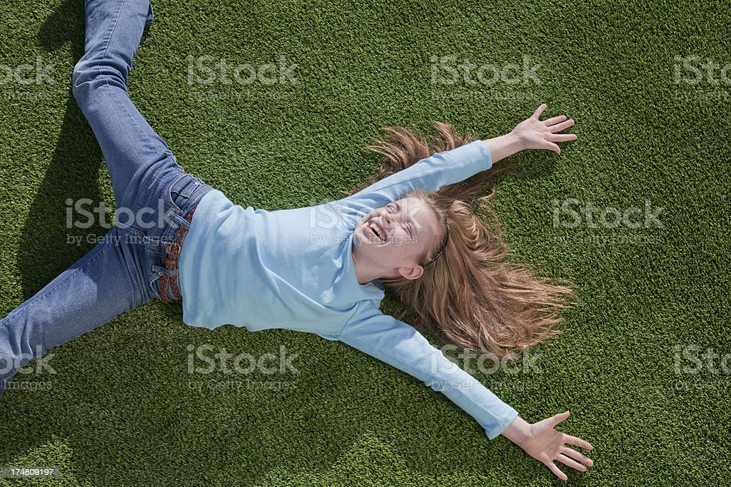 Relaxing stretch in warm summer sun royalty-free stock photo