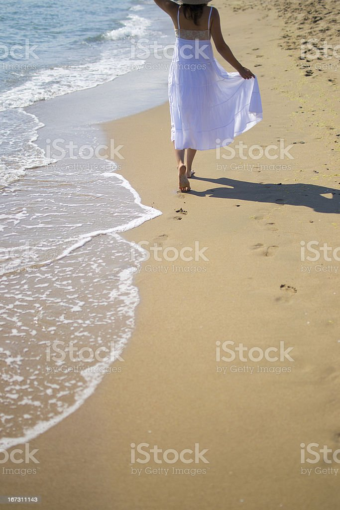 Relaxing stroll along the beach royalty-free stock photo
