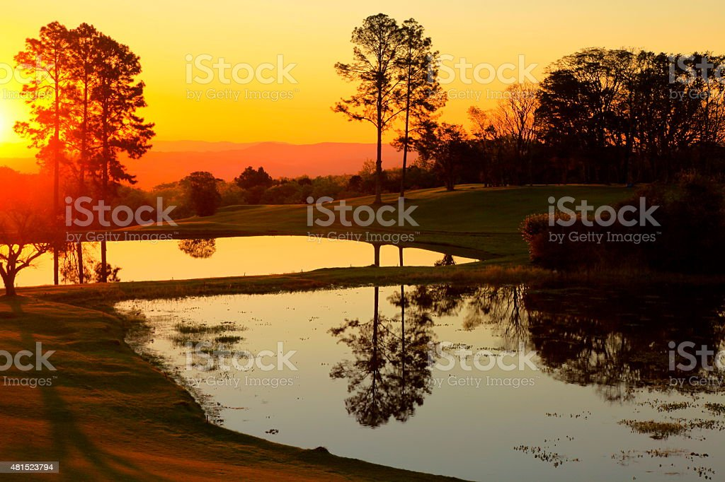 Relaxing sunset landscape with lake reflection, Gramado, Brazil stock photo
