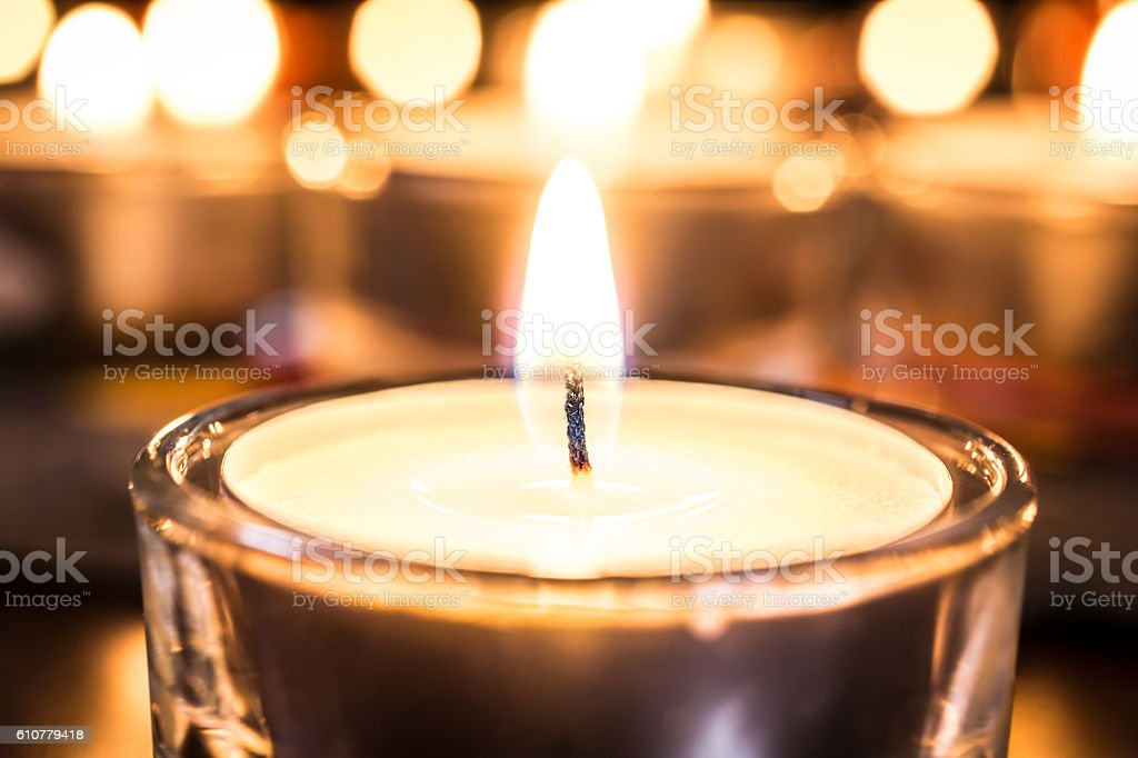 Relaxing Tealight With A Bokeh Of Several Candles stock photo
