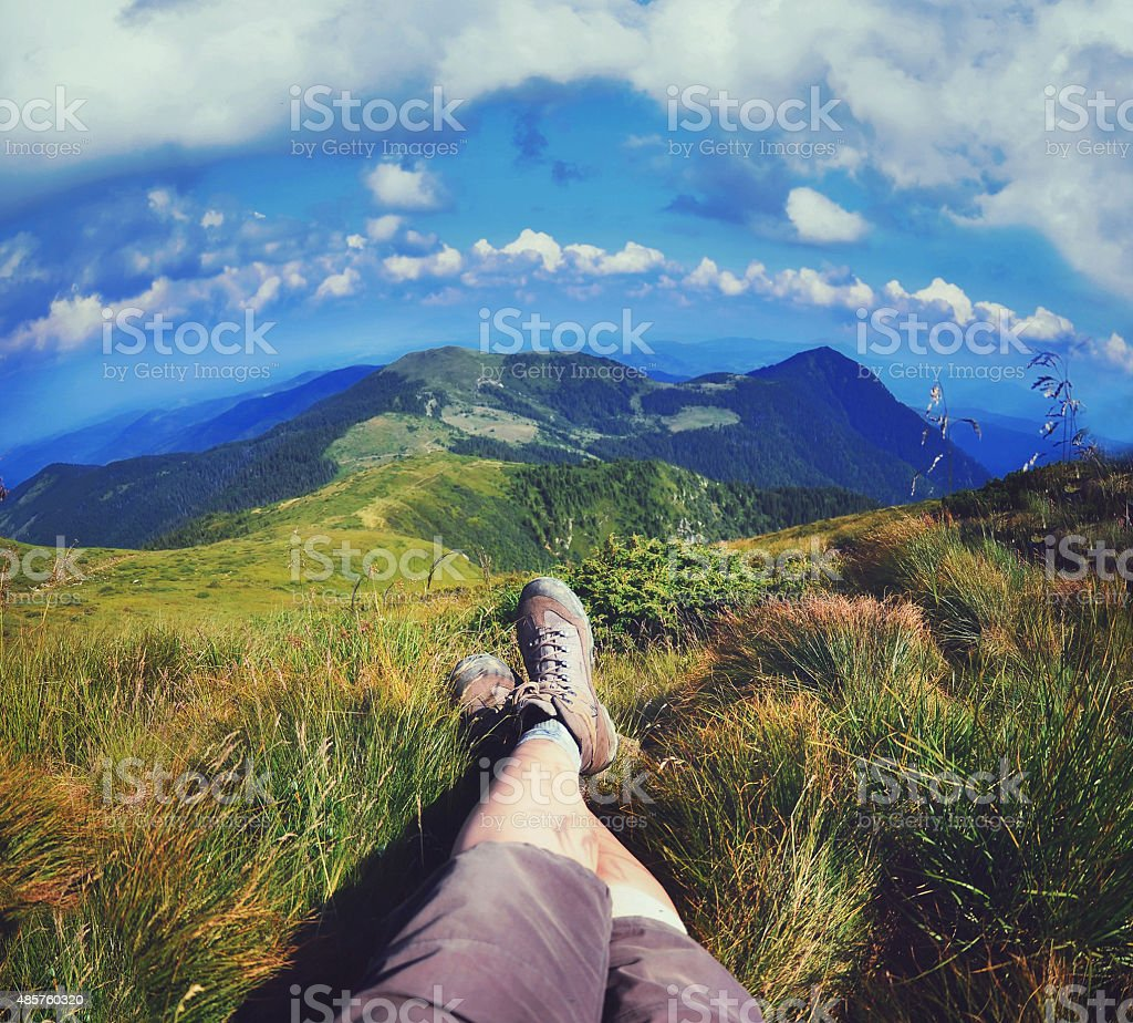 Relaxing time during an outdoor trekking in mountains stock photo