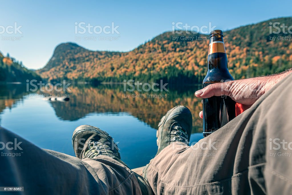POV Relaxing Time During Outdoor Trekking in Mountains, Lake, Autumn stock photo
