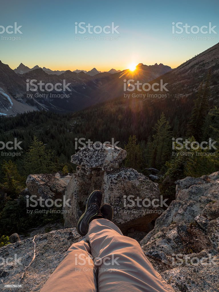 Relaxing to a setting sun stock photo
