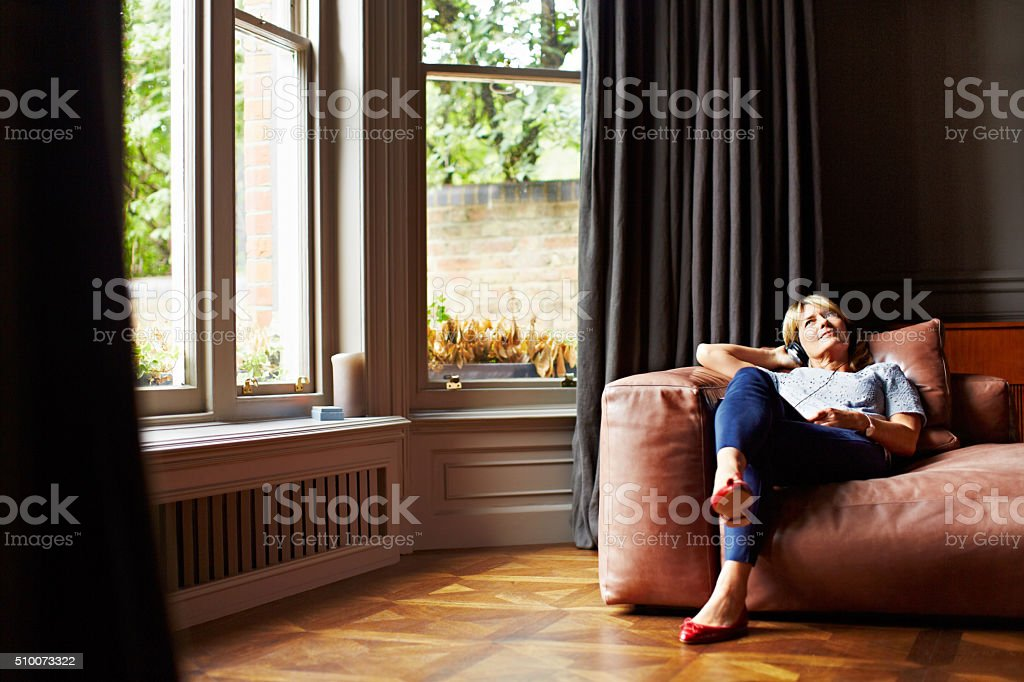 Relaxing to some soothing music stock photo