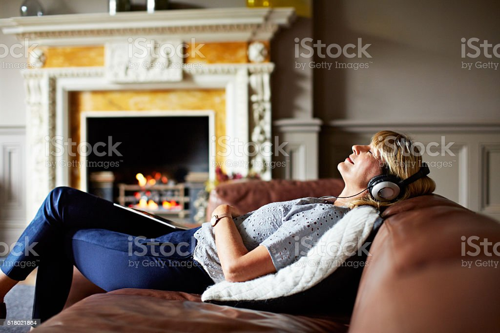 Relaxing to some soothing sounds stock photo