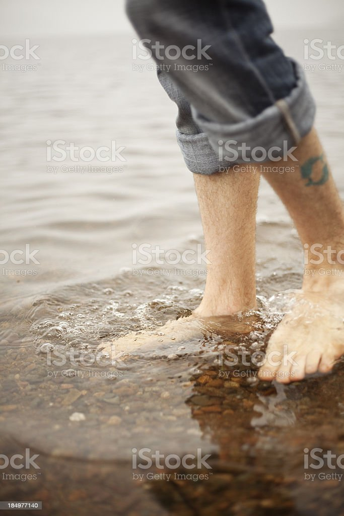 Relaxing walk in water close up royalty-free stock photo