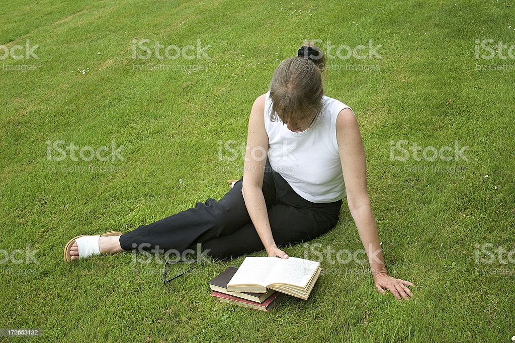 Relaxing with a book royalty-free stock photo