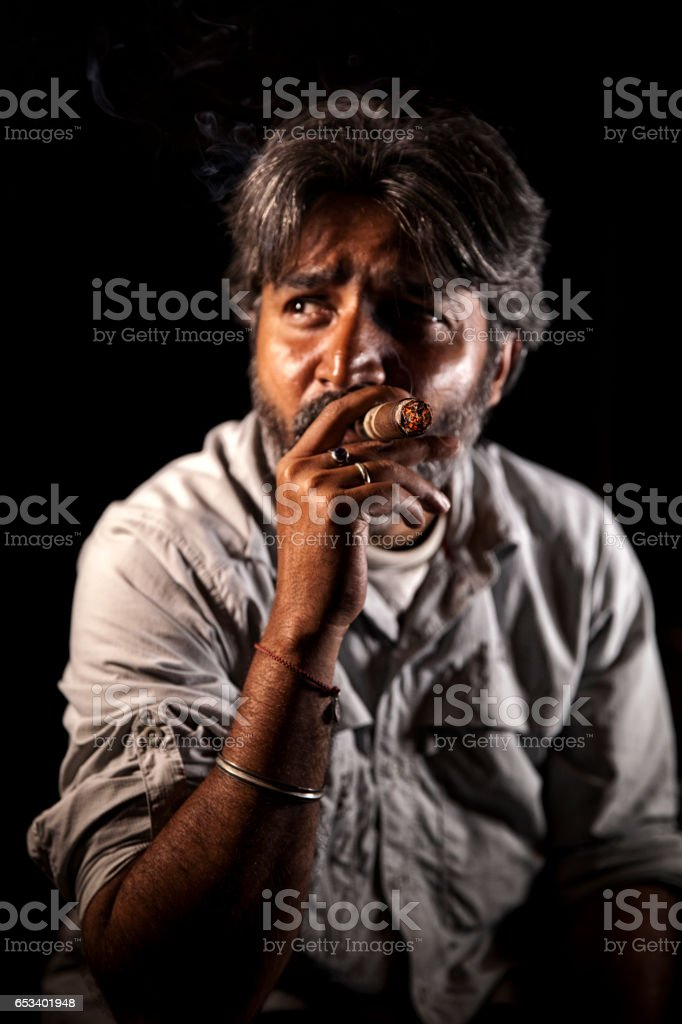 Relaxing with a cigar. stock photo