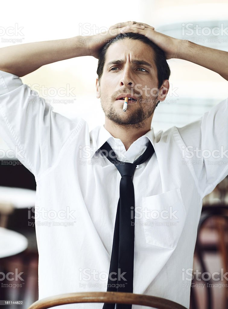 Relaxing with a smoke after work royalty-free stock photo