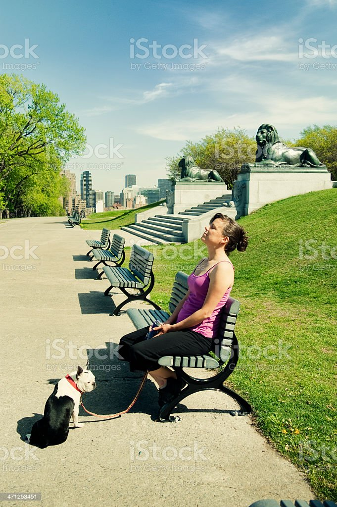 Relaxing with dog in the city park. royalty-free stock photo
