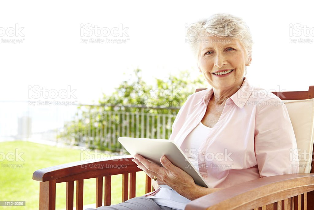 Relaxing with her digital reader royalty-free stock photo