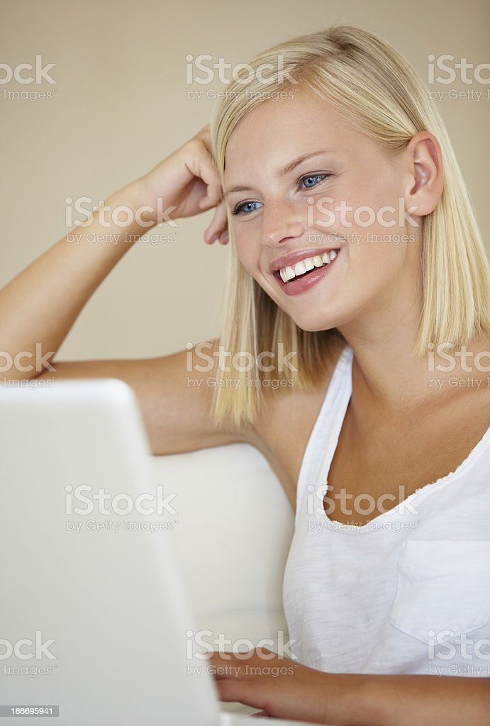 Relaxing with her fast internet connection royalty-free stock photo