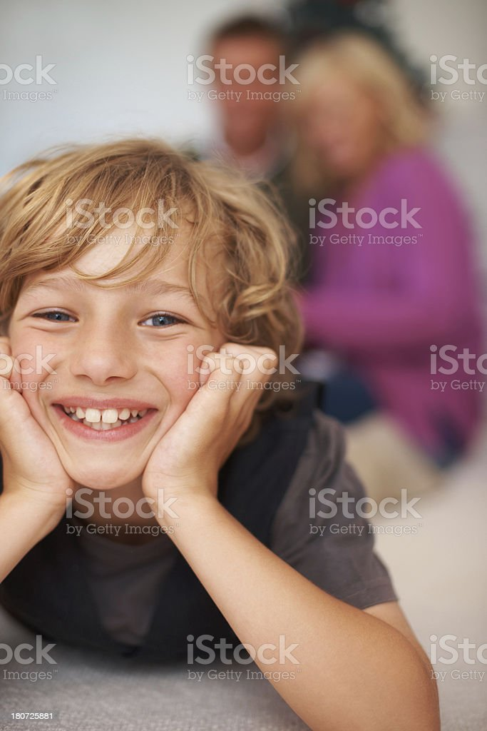 Relaxing with his parents royalty-free stock photo