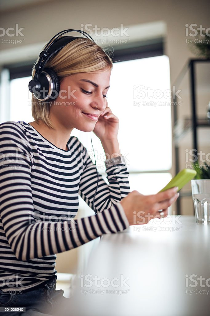 Relaxing with music stock photo