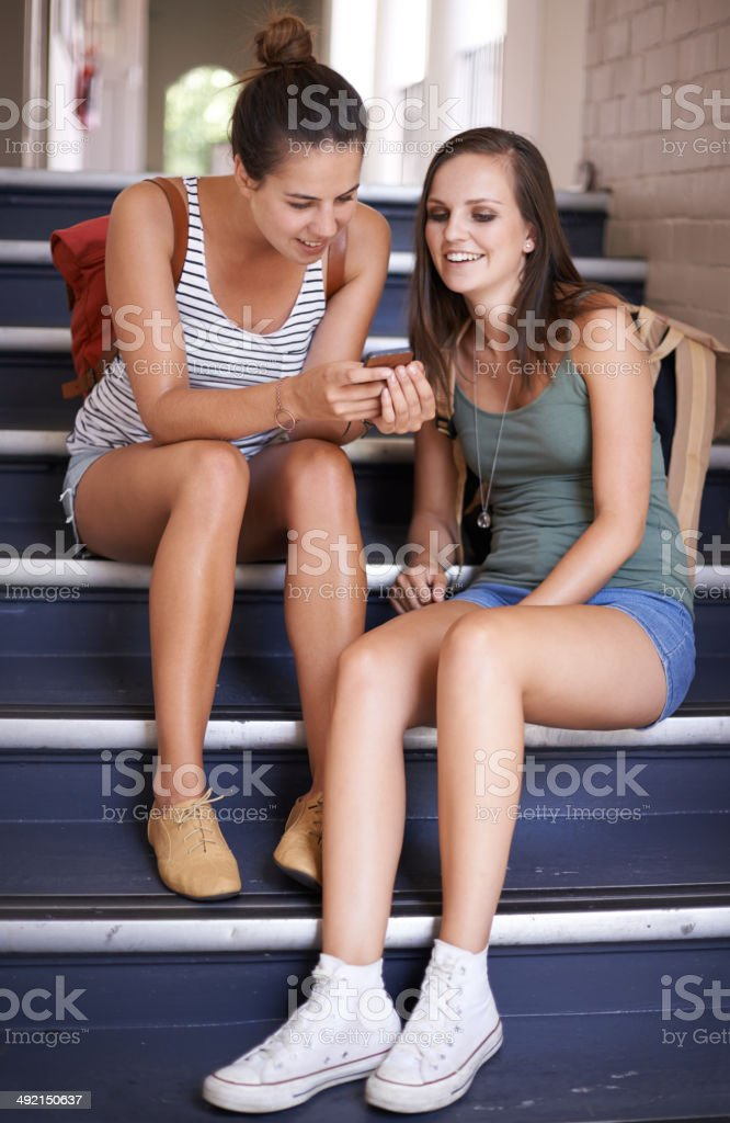Relaxing with my bestie between class royalty-free stock photo