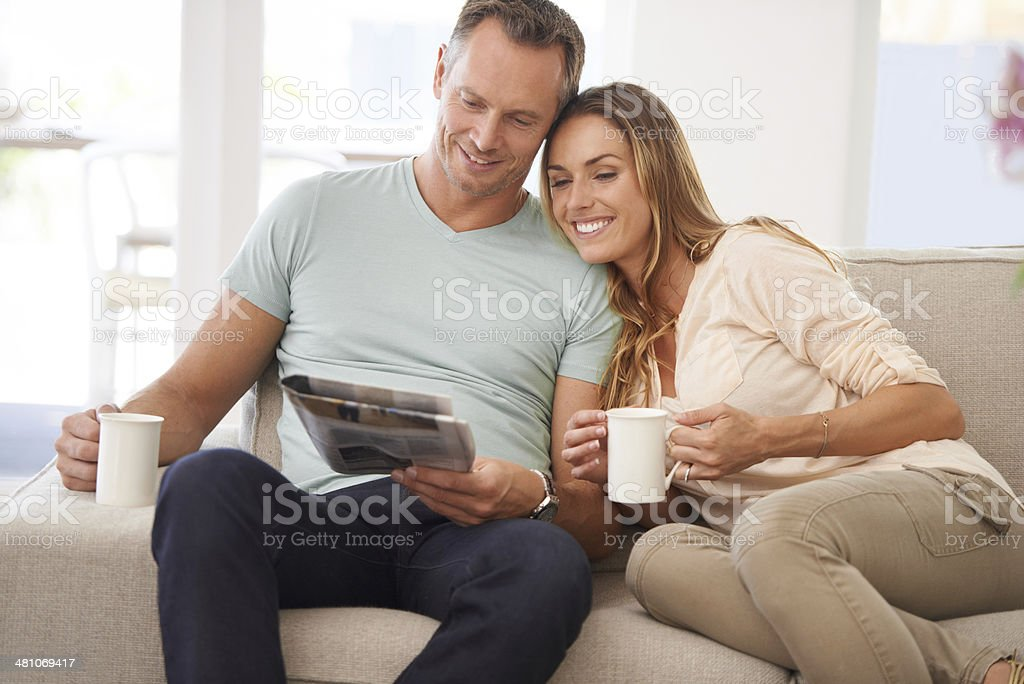Relaxing with the morning paper royalty-free stock photo