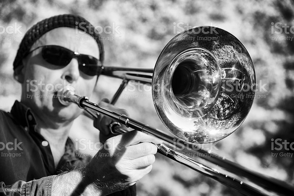 Relaxing with trombone in the park stock photo