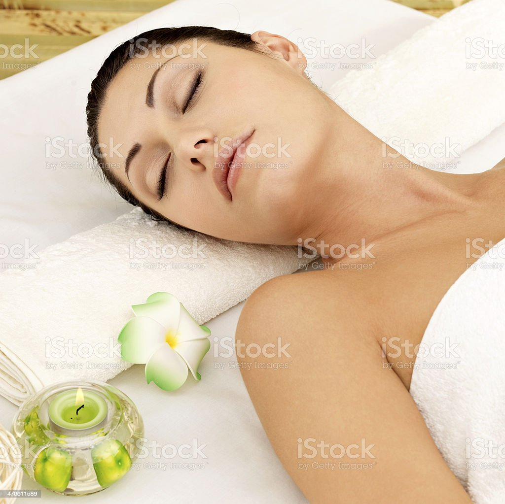 Relaxing woman at beauty spa salon royalty-free stock photo