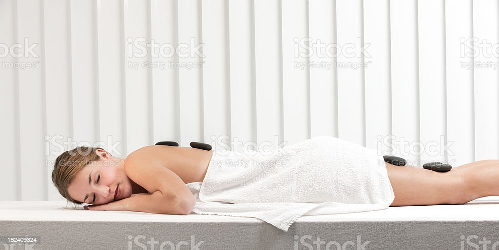 relaxing woman having lastone therapy royalty-free stock photo