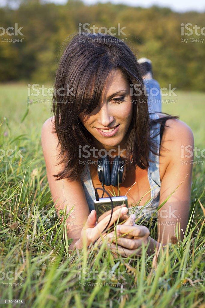 relaxing woman in meadow stock photo