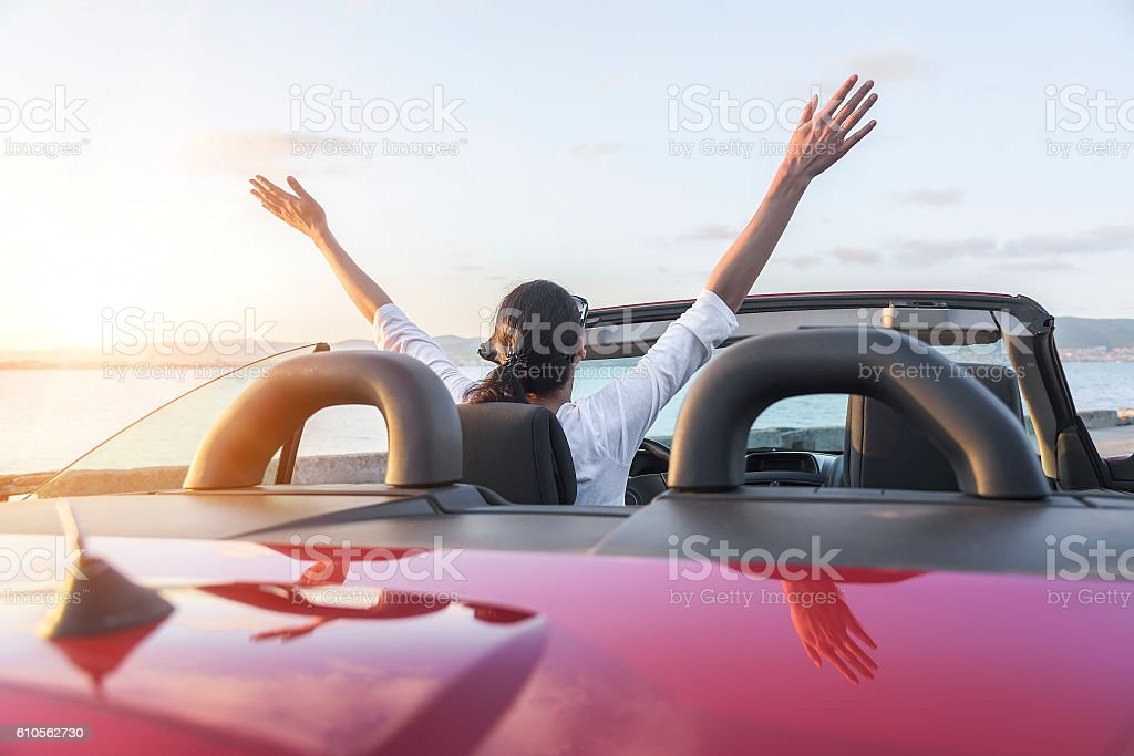 Relaxing woman on the beach in the car. stock photo