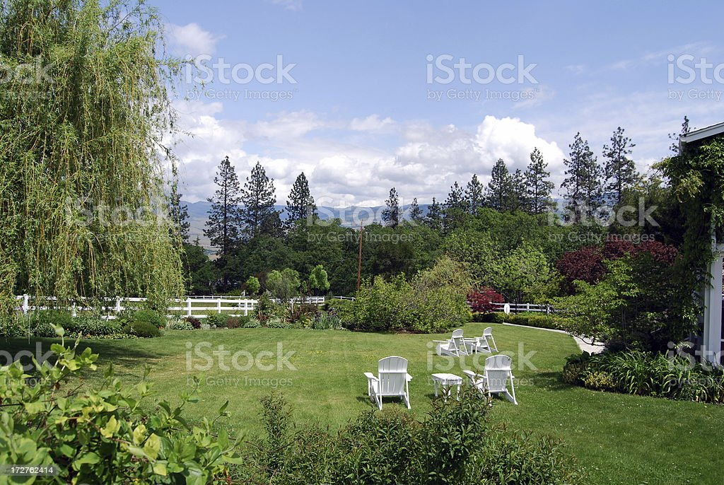 Relaxing Yard with Lawn Chairs stock photo