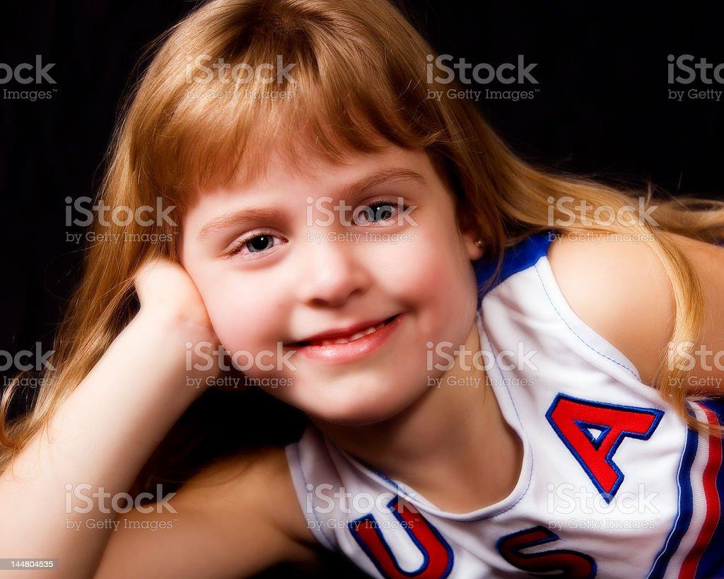 Relaxing Young Cheerleader stock photo