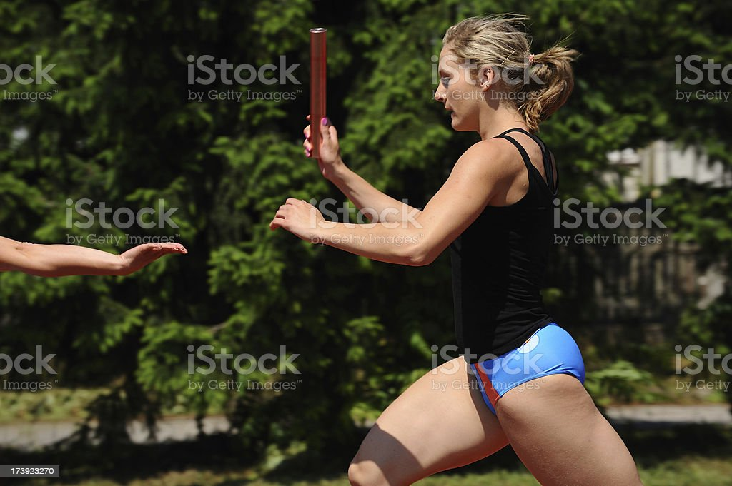 Relay passing royalty-free stock photo