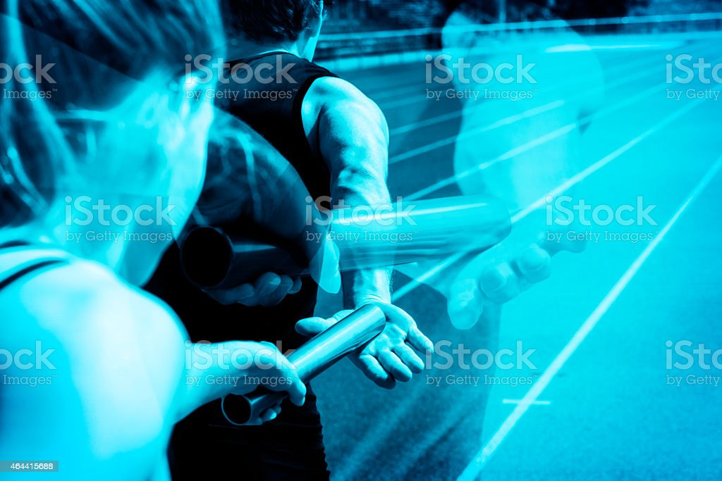 Relay race handing over ghosting stock photo