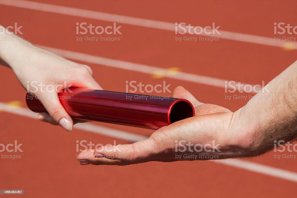 Relay race handing over stock photo