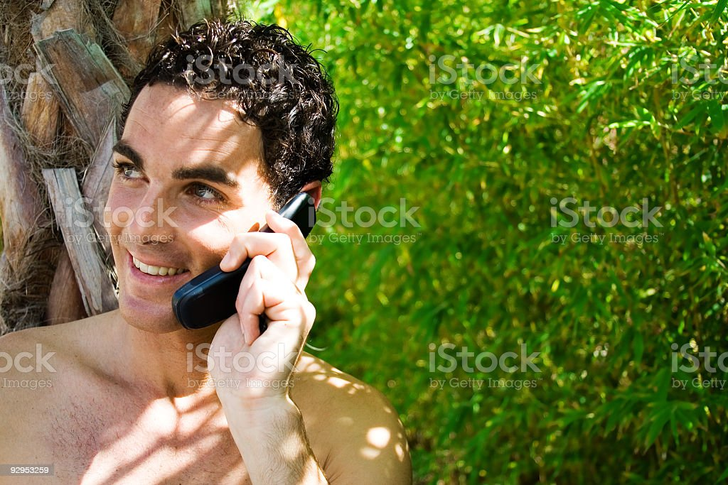 Releaxed young man with mobile phone royalty-free stock photo