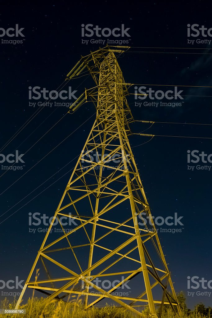 Reliance power lines in the darkness stock photo