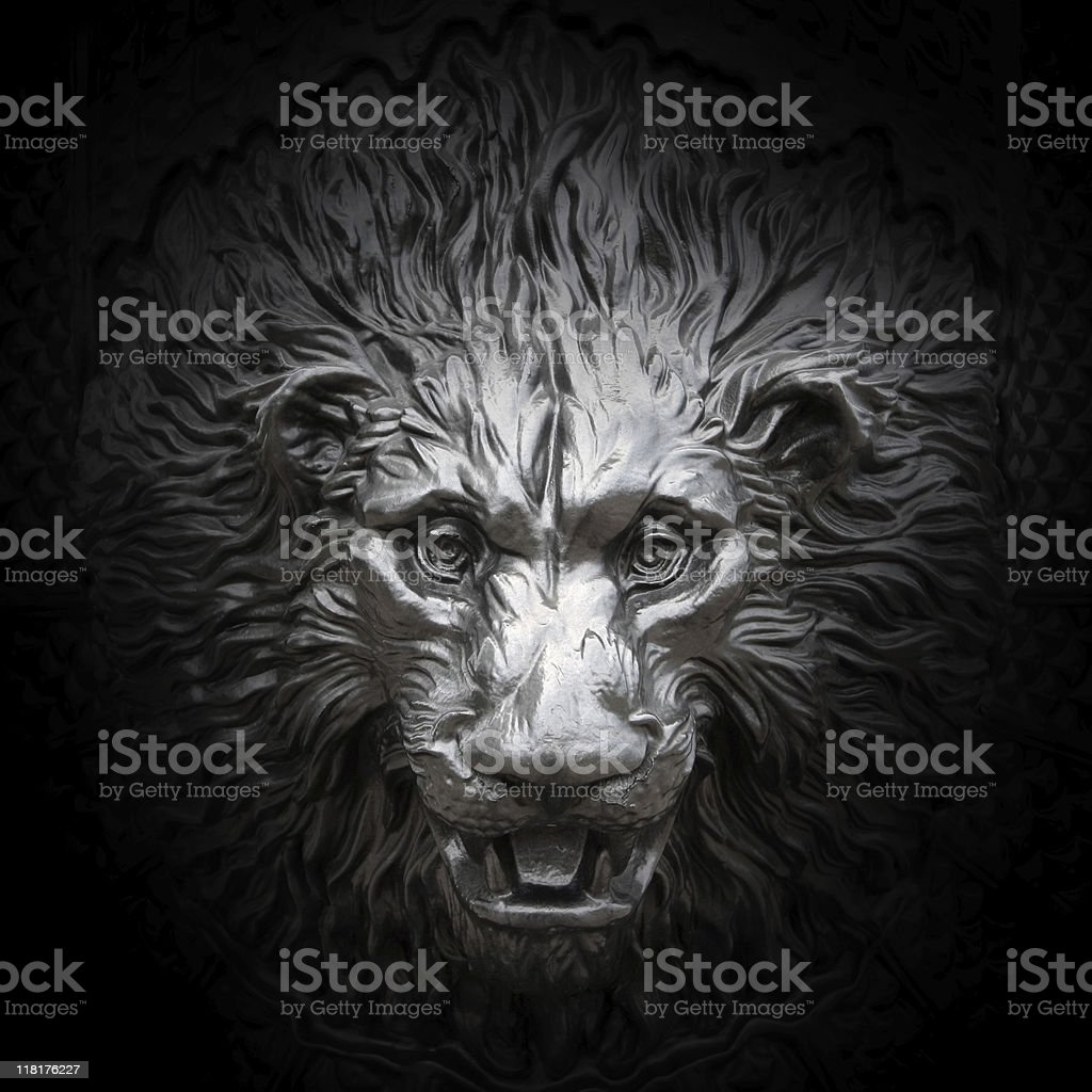 Relief of a lion head stock photo