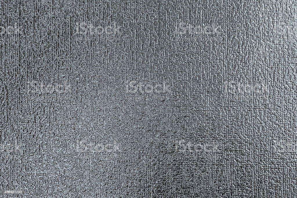 relief texture on glossy wallpaper stock photo