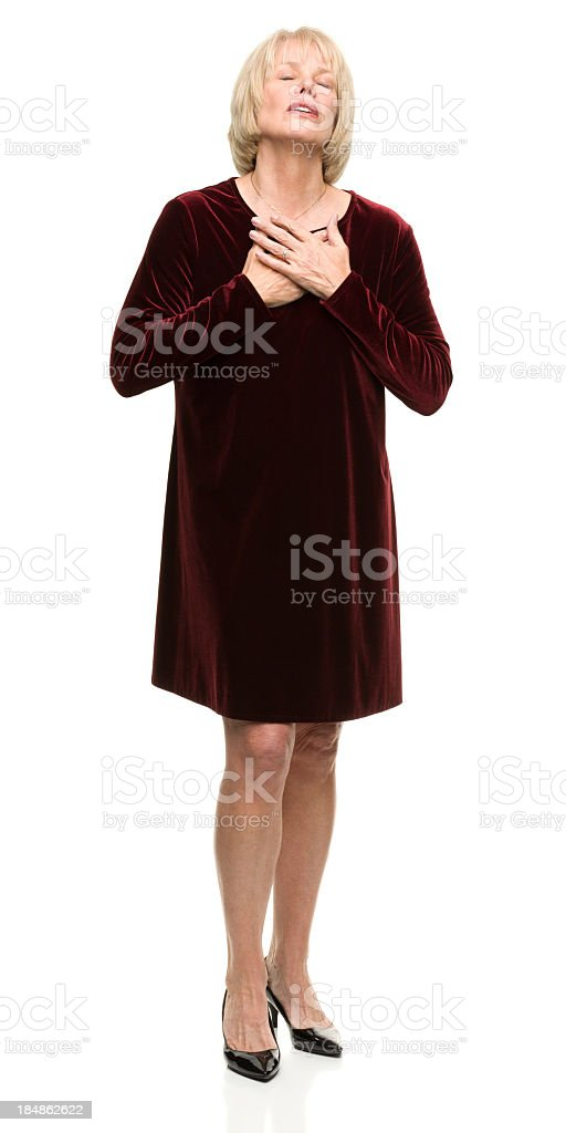 Relieved Woman Holds Hands to Chest stock photo