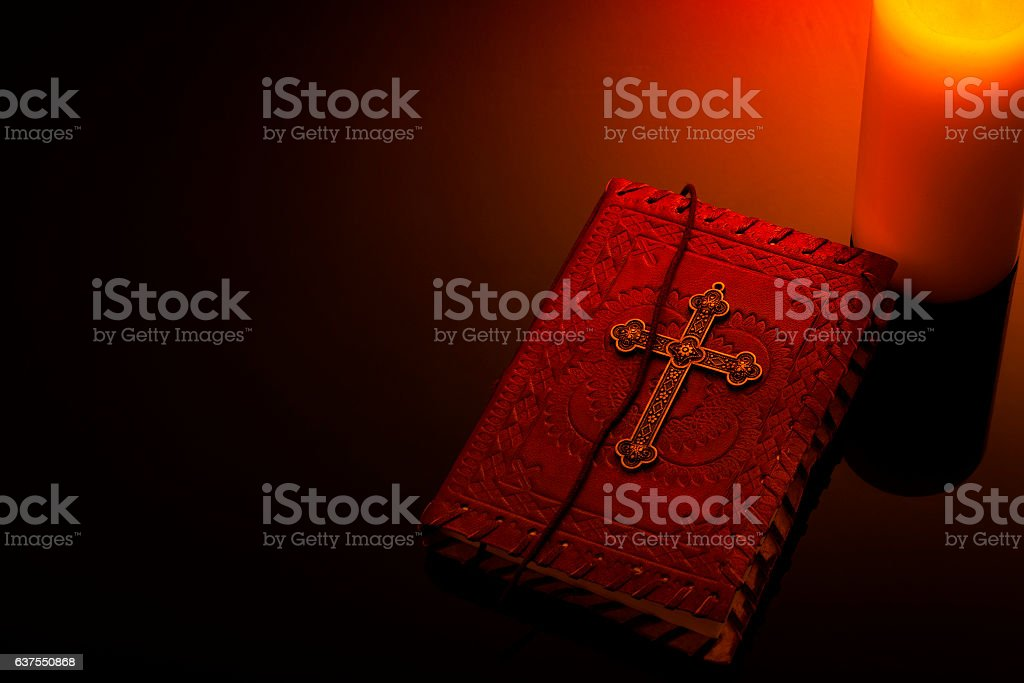Religion and christianity concept with bible and candle and copyspace stock photo