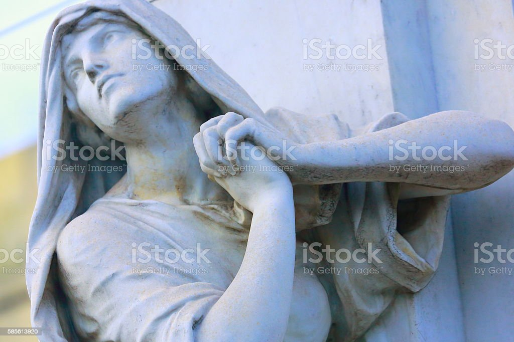 Religion hope: Pensive Madonna praying hands clasped, Recoleta cemetery stock photo
