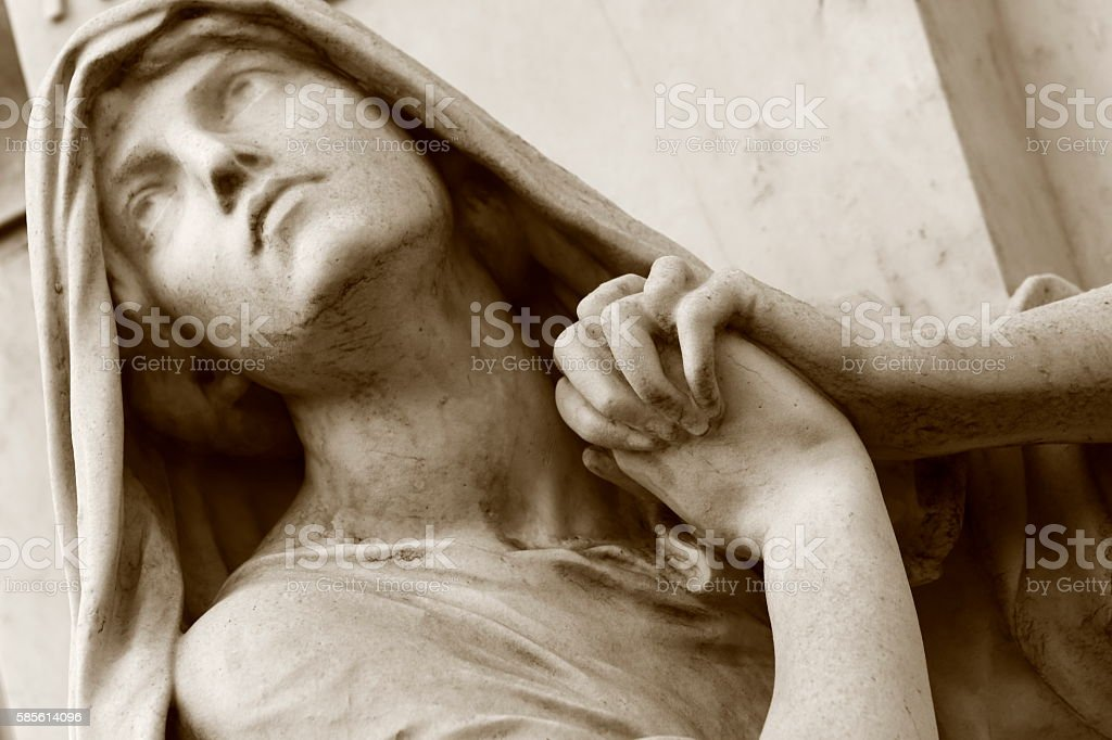 Religion hope: Sepia Madonna praying hands looking to sky, Recoleta stock photo
